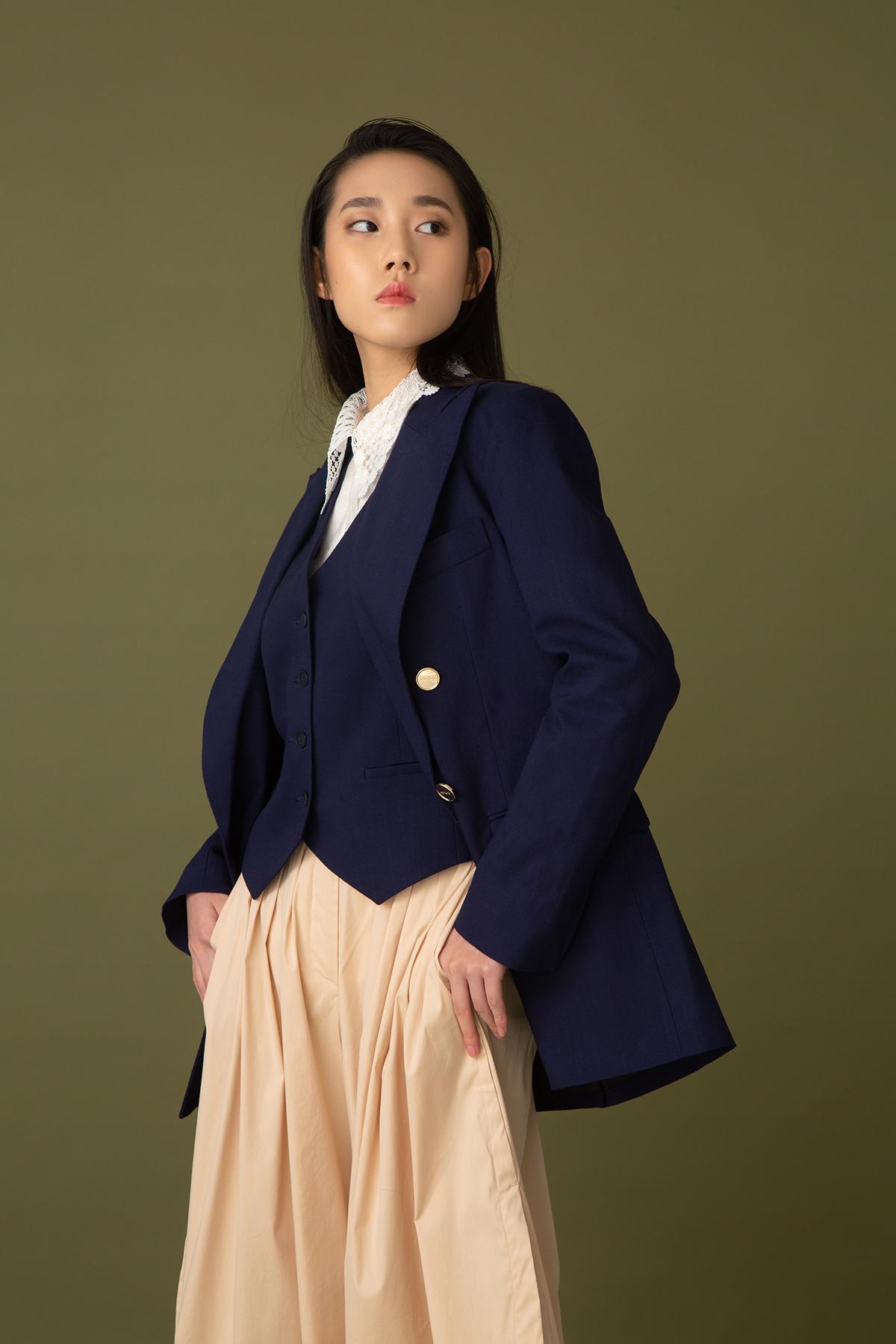 Sandro blue waistcoat, white shirt & blazer  Marella khaki culottes $2,480 H&M black sandals $229 Sportmax handbag $5,880