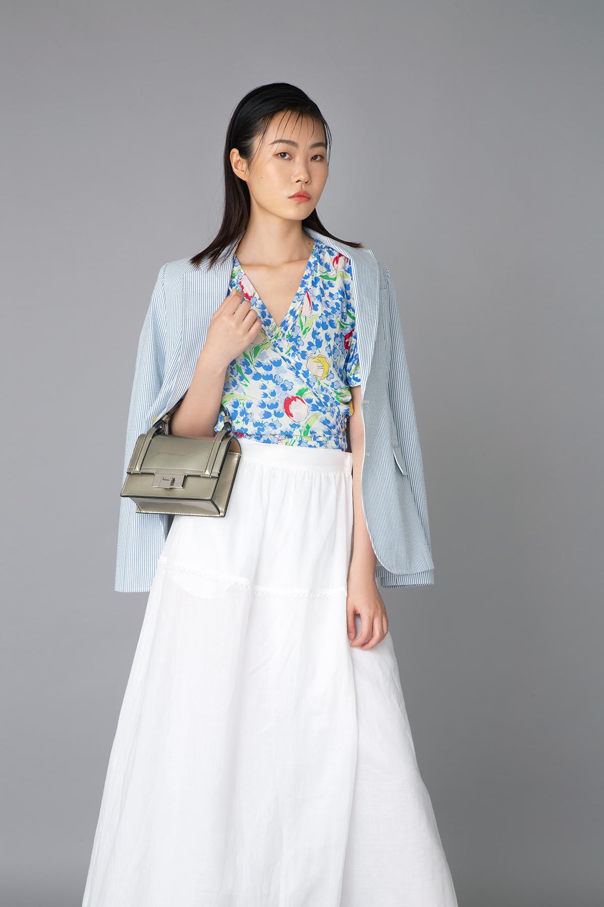 Polo Ralph Lauren blue floral printed shirt $1,990 ,blue blazer $3,990 and small leather handbag $13,300 Max Mara white dress $4,580