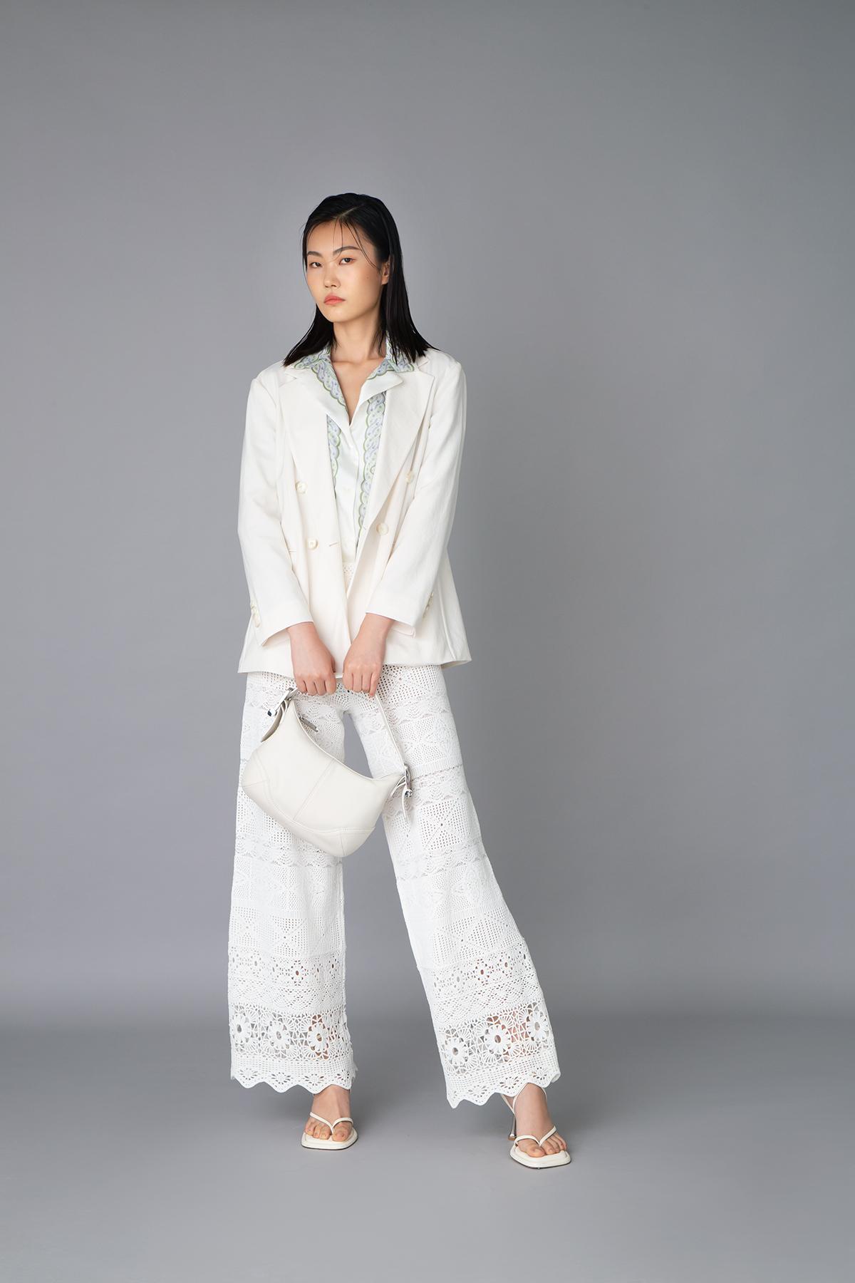 Sandro green floral printed shirt $2,090 Hugo Boss white blazer $4,500 Maje white crochet pants $2,690 Hugo Boss white leather handbag $5,100 Sportmax white sandals (Price to be confirmed)