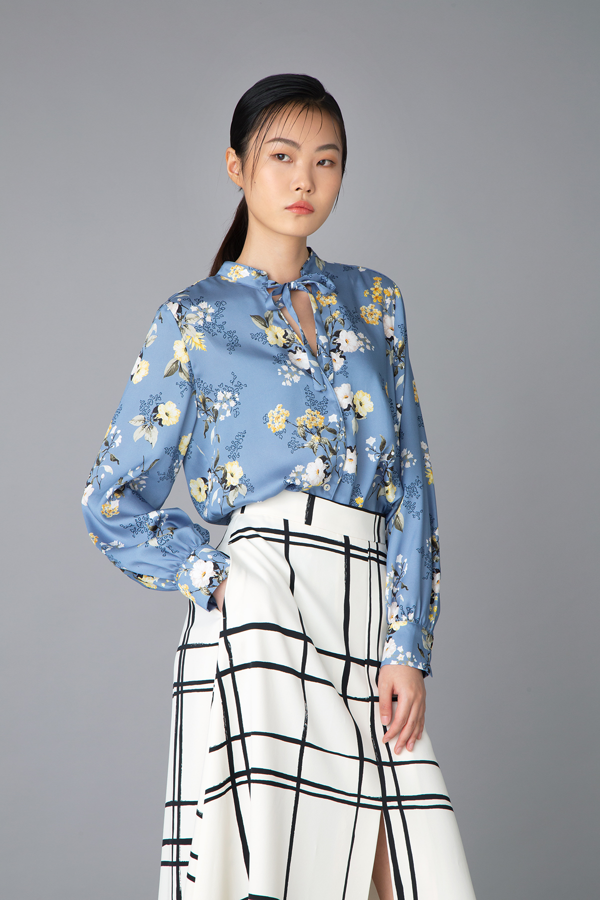 iBlues blue floral printed silk top $1,780 Marella white checked skirt $2,480