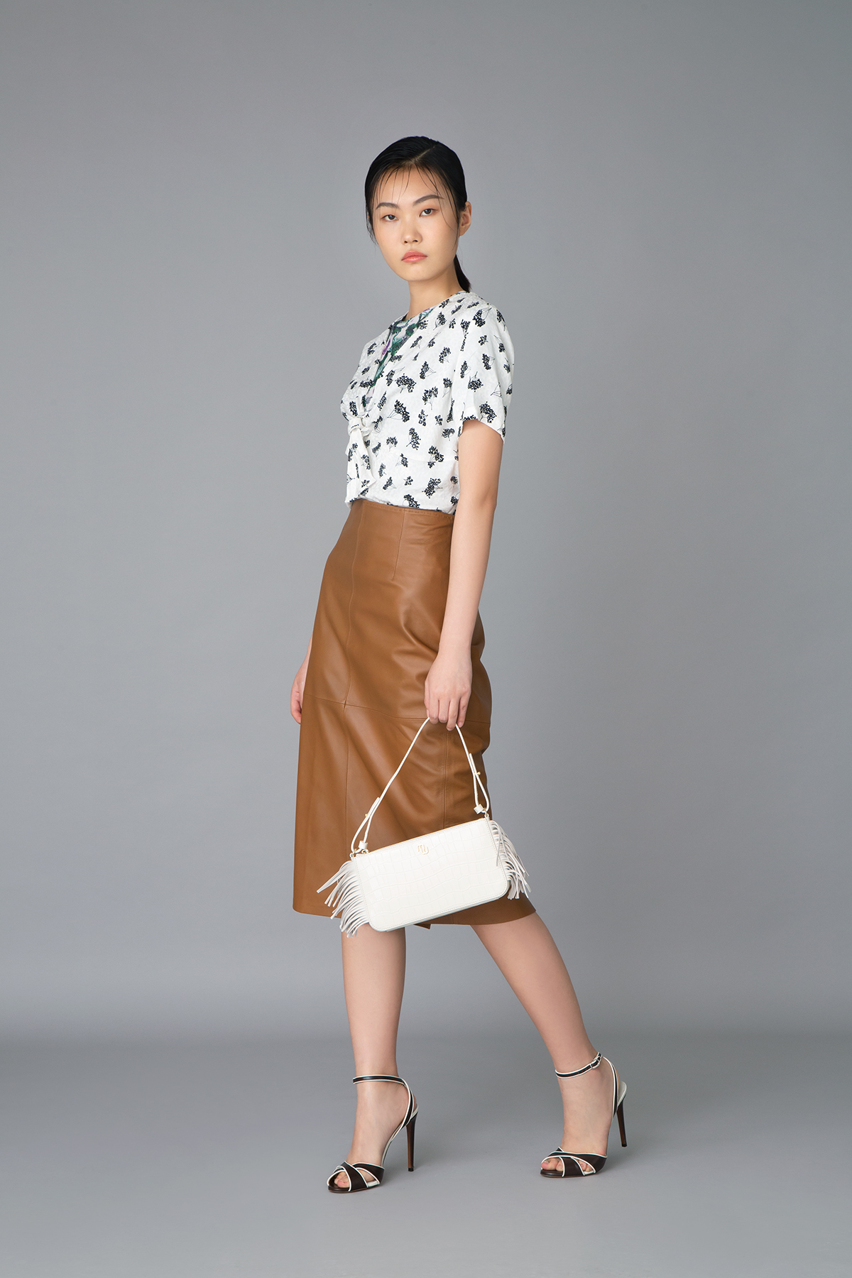 Maje green floral printed jersey top $1,045 and white floral printed cotton shirt $1,790 Max Mara brown leather skirt $6,980 Polo Ralph Lauren high heels (Price to be confirmed) Maje white handbag $2,345