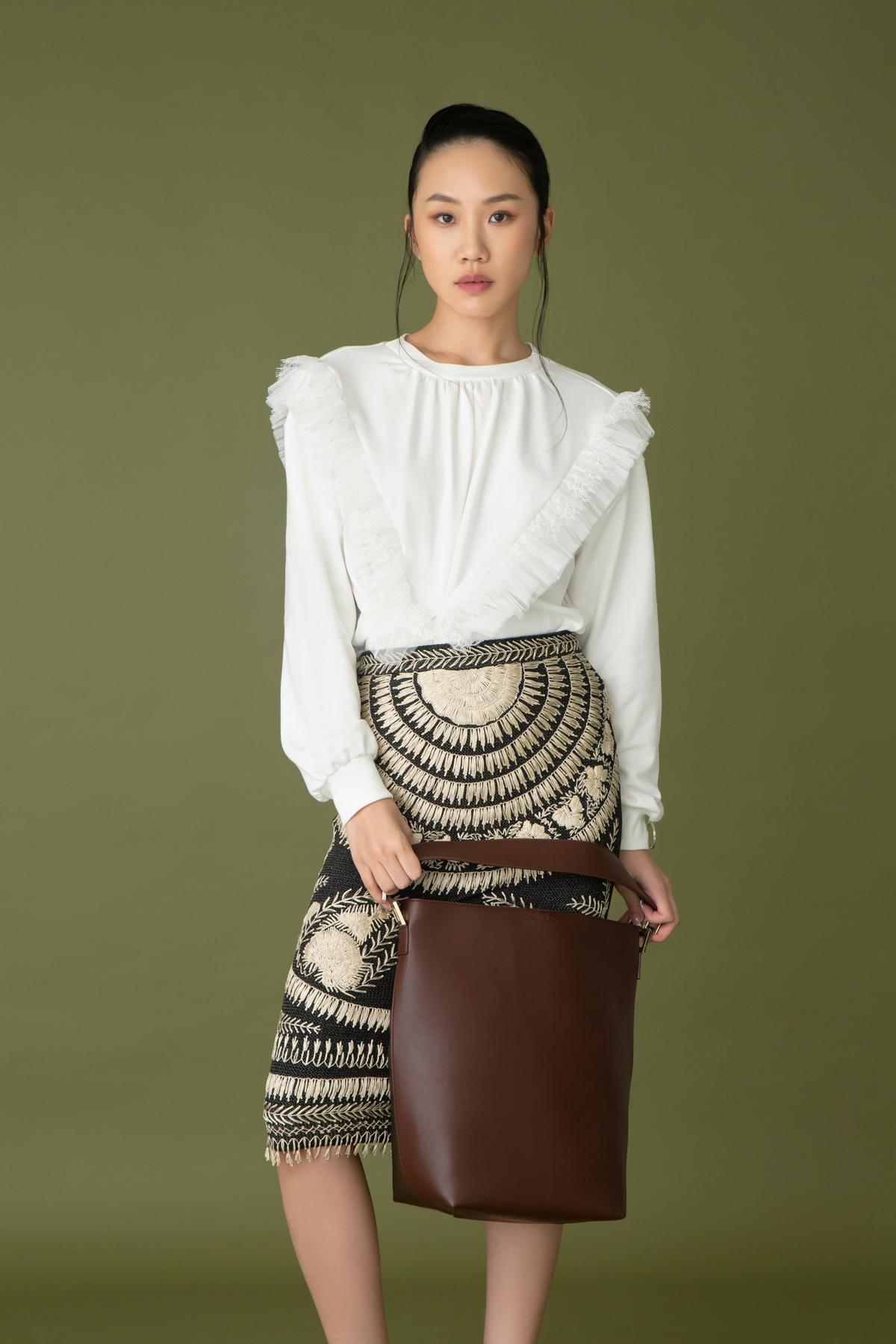 Act N1 x Marella white ruffles top $2,280  Ralph Lauren embroidery skirt $16,300 Penny Black buckle bag $1,480