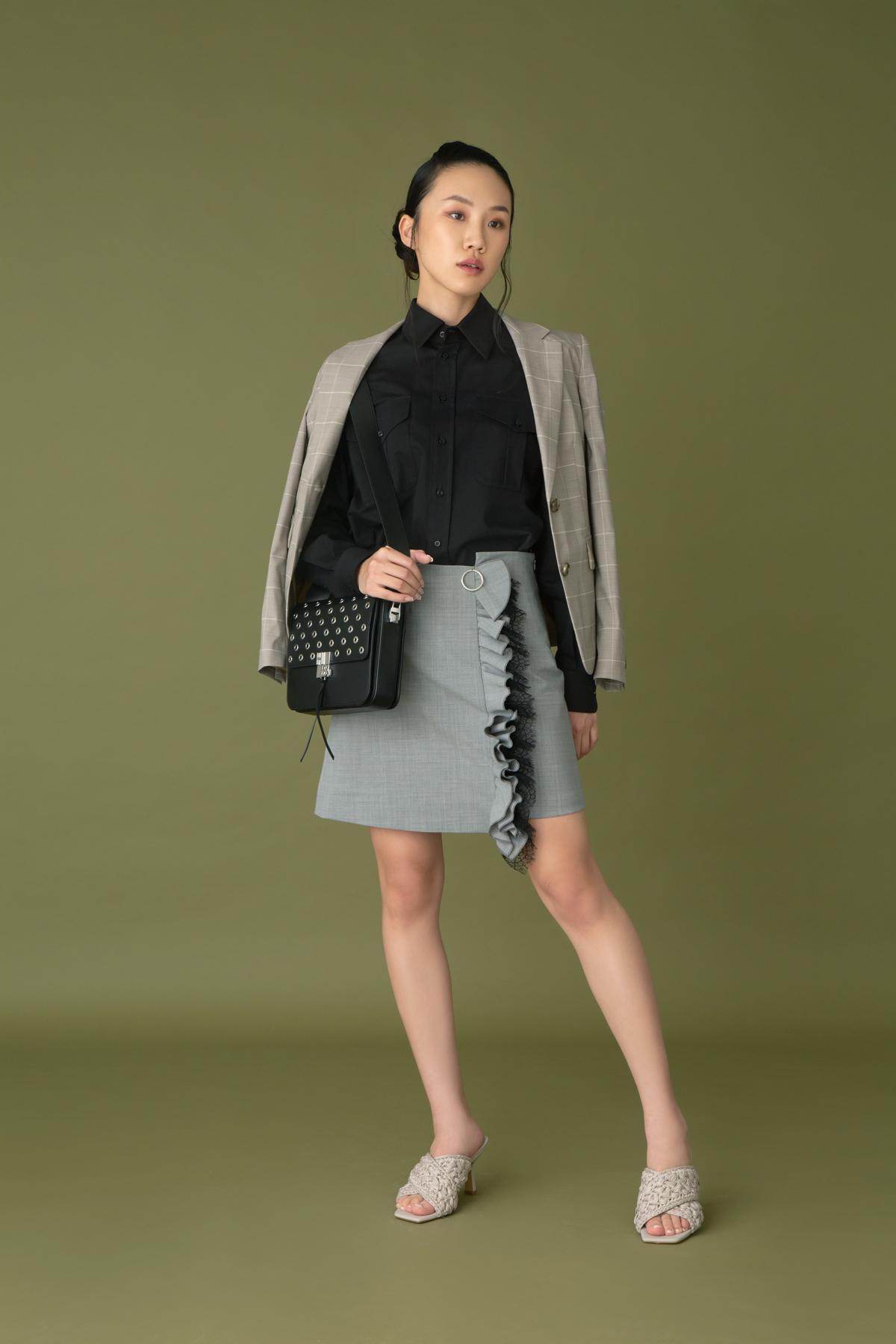 Ralph Lauren black cotton shirt $5,800 Hugo Boss checked blazer $4,500 Act N1 x Marella checked ruffles skirt $1,980 Hugo Boss leather handbag with studs $7,300 H&M beige sandals $349