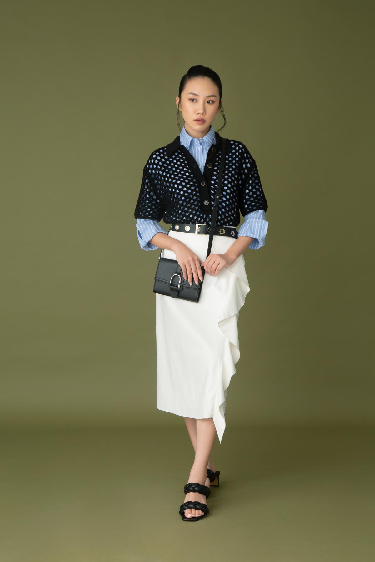 H&M blue striped shirt $329 and black netted top $329 Marina Rinaldi white ruffles skirt $6,280 Penny Black leather belt $980 Ralph Lauren leather handbag $9,900 H&M black sandals $279