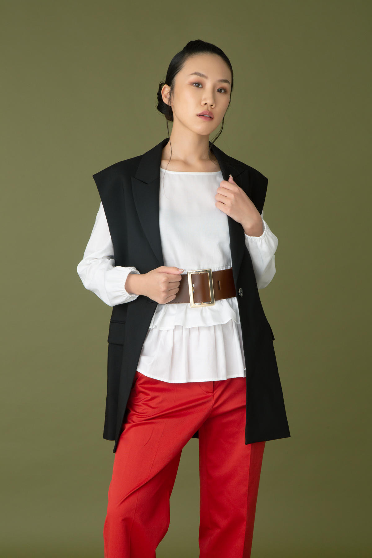 Penny Black white cotton ruffles top $1,680 and leather belt $1,080 H&M black oversize waistcoat $899  Hugo Boss red cotton pants $2,600