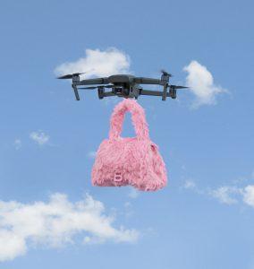 BALENCIAGA-QIXI-pink-hourglass-furry-bag-drone